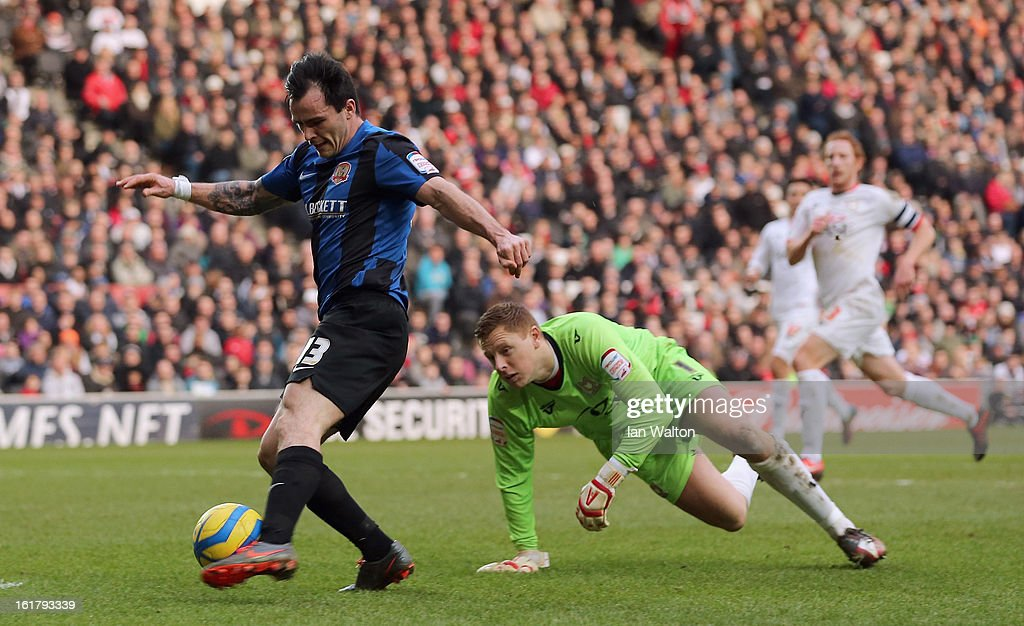 Chris Dagnall of Barnsley scores his team's third goal during the FA Cup Fifth Round match between MK Dons and Barnsley at StadiumMK on February 16, 2013 in Milton Keynes, England.