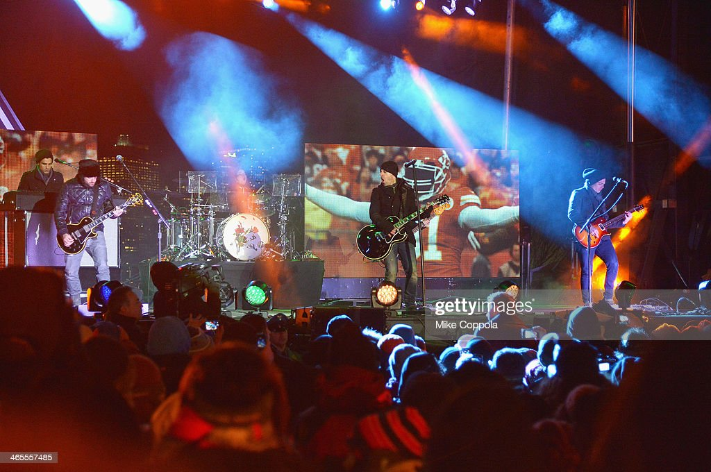 <a gi-track='captionPersonalityLinkClicked' href=/galleries/search?phrase=Chris+Daughtry&family=editorial&specificpeople=614842 ng-click='$event.stopPropagation()'>Chris Daughtry</a> (C) of the rock band Daughtry perfoms at the Super Bowl Kickoff Spectacular at Liberty State Park on January 27, 2014 in Jersey City, New Jersey.