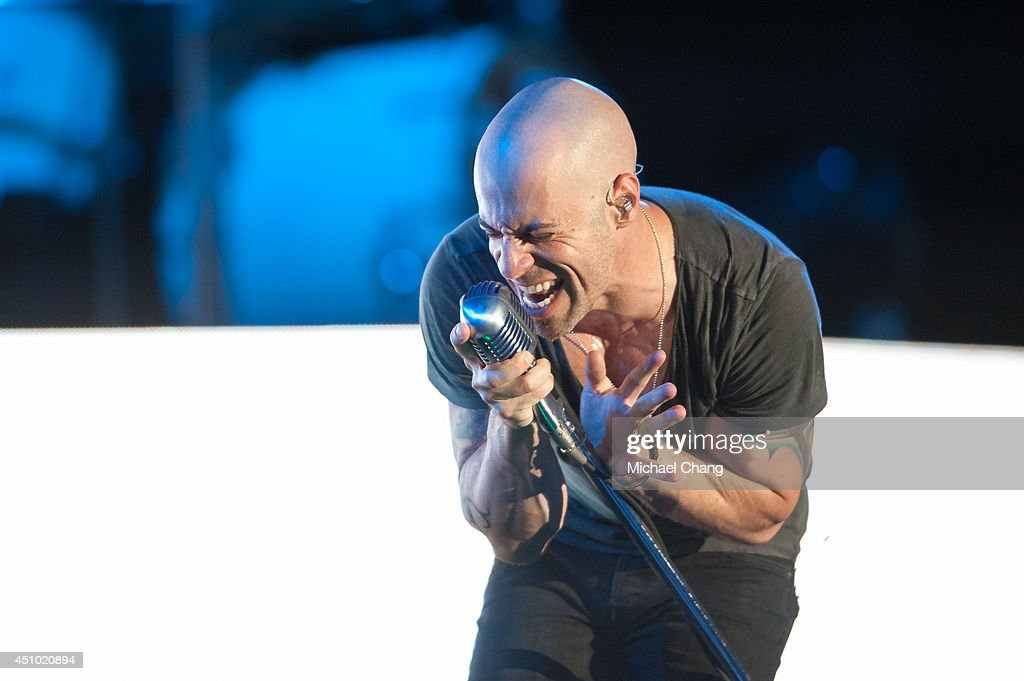 <a gi-track='captionPersonalityLinkClicked' href=/galleries/search?phrase=Chris+Daughtry&family=editorial&specificpeople=614842 ng-click='$event.stopPropagation()'>Chris Daughtry</a> performs in concert at The Amphitheater at the Wharf on June 21, 2014 in Orange Beach, Alabama.