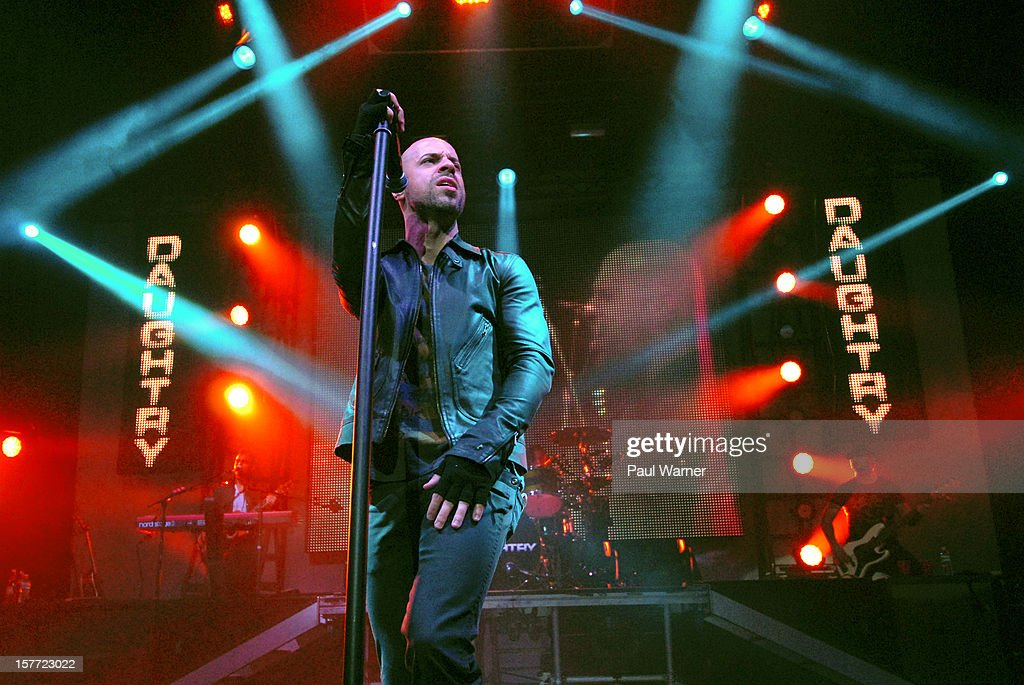 <a gi-track='captionPersonalityLinkClicked' href=/galleries/search?phrase=Chris+Daughtry&family=editorial&specificpeople=614842 ng-click='$event.stopPropagation()'>Chris Daughtry</a> performs with Daughtry at Fox theater on December 5, 2012 in Detroit, Michigan.