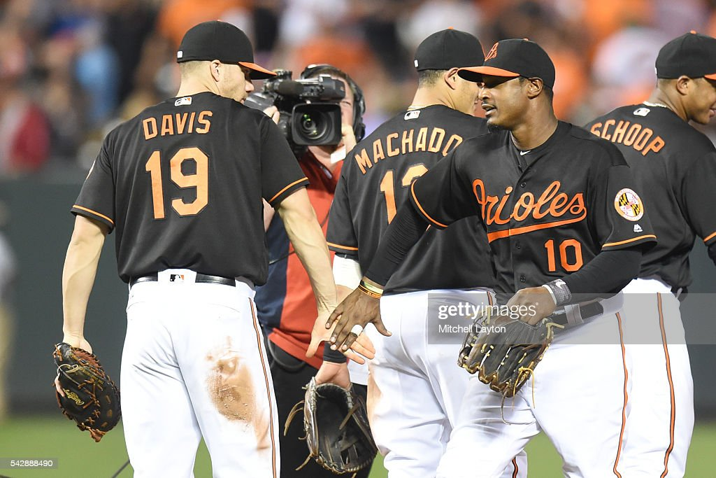 Chris Davis #19 and <a gi-track='captionPersonalityLinkClicked' href=/galleries/search?phrase=Adam+Jones+-+Baseball+Player&family=editorial&specificpeople=5460465 ng-click='$event.stopPropagation()'>Adam Jones</a> #10 of the Baltimore Orioles celebrate a win after a baseball game against the Tampa Bay Rays at Oriole Park at Camden Yards on June 24, 2016 in Baltimore, Maryland. The Orioles won 6-3.