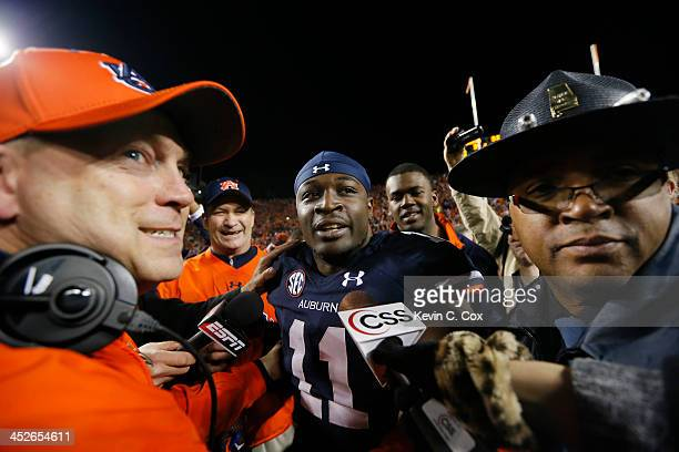 Chris Davis of the Auburn Tigers celebrates with coaching staff after scoring the winning touchdown to defeat the Alabama Crimson Tide 34 to 28 at...