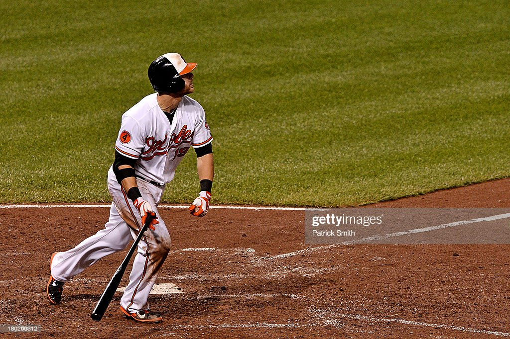 Chris Davis #19 of the Baltimore Orioles a home run against the New York Yankees in the fifth inning at Oriole Park at Camden Yards on September 10, 2013 in Baltimore, Maryland.