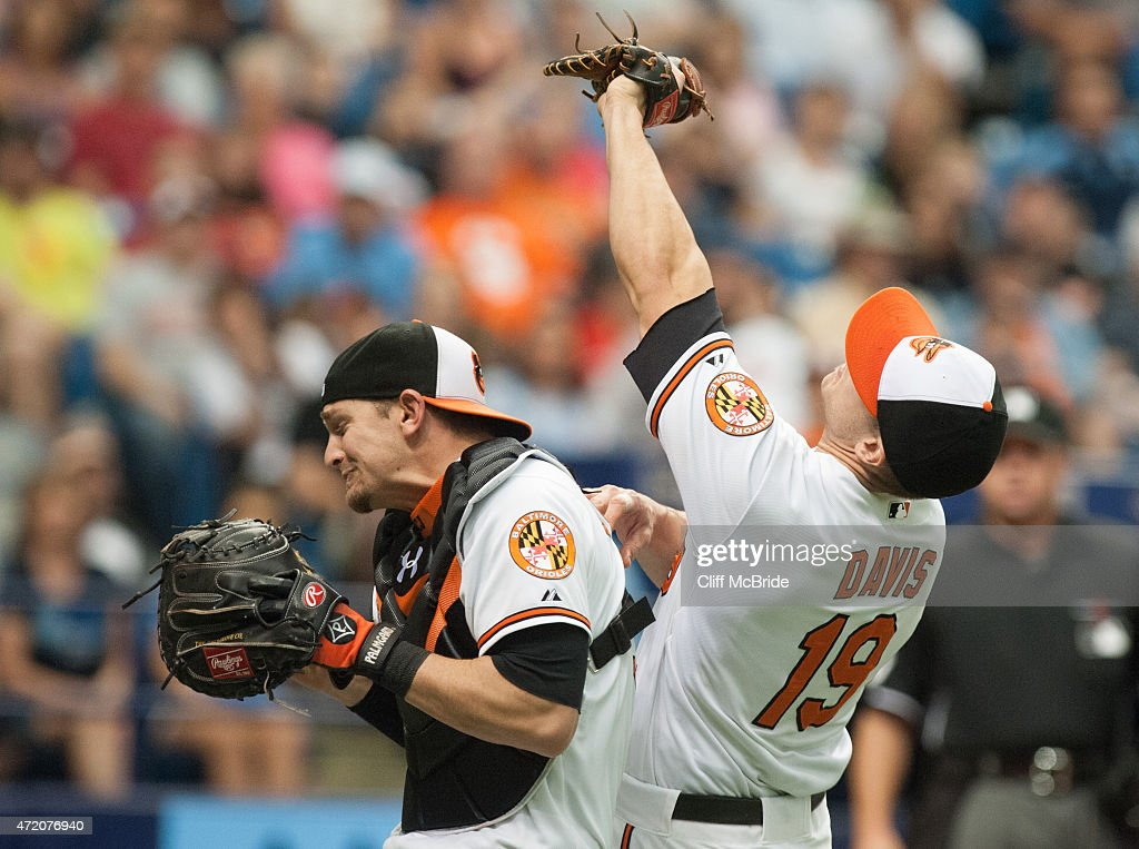 <a gi-track='captionPersonalityLinkClicked' href=/galleries/search?phrase=Chris+Davis+-+Baseball&family=editorial&specificpeople=7129264 ng-click='$event.stopPropagation()'>Chris Davis</a> #19 of the Baltimore Orioles and <a gi-track='captionPersonalityLinkClicked' href=/galleries/search?phrase=Caleb+Joseph+-+Baseball+Player&family=editorial&specificpeople=15741618 ng-click='$event.stopPropagation()'>Caleb Joseph</a> #36 of the Baltimore Orioles bump one another as Davis makes the catch against the Tampa Bay Rays in the seventh inning on May 3, 2015 at Tropicana Field in St. Petersburg, Florida. The three-game series was moved to Tropicana Field due to the civil unrest in Baltimore after the arrest and death of Freddie Gray. The Baltimore Orioles were designated the home team for the series.