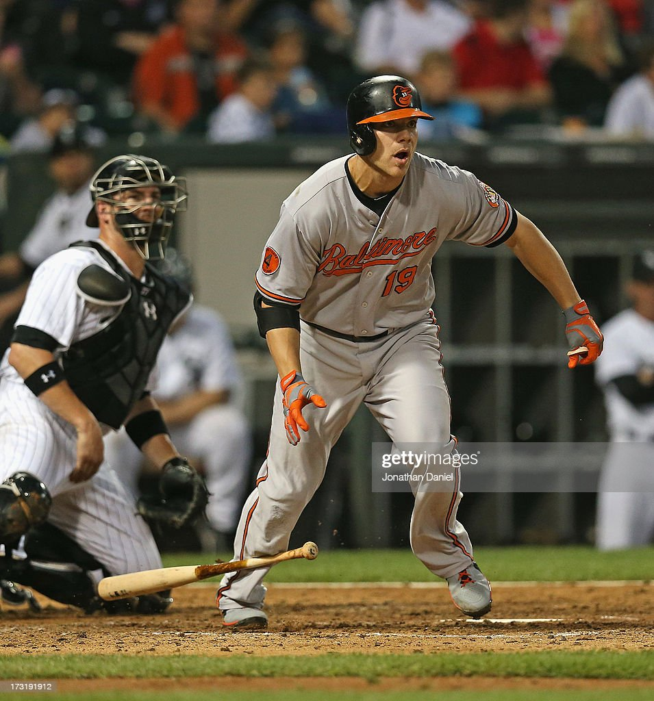 Chris Davis #19 of the Baltimore Orioles bats and runs against the Chicago White Sox at U.S. Cellular Field on July 3, 2013 in Chicago, Illinois.