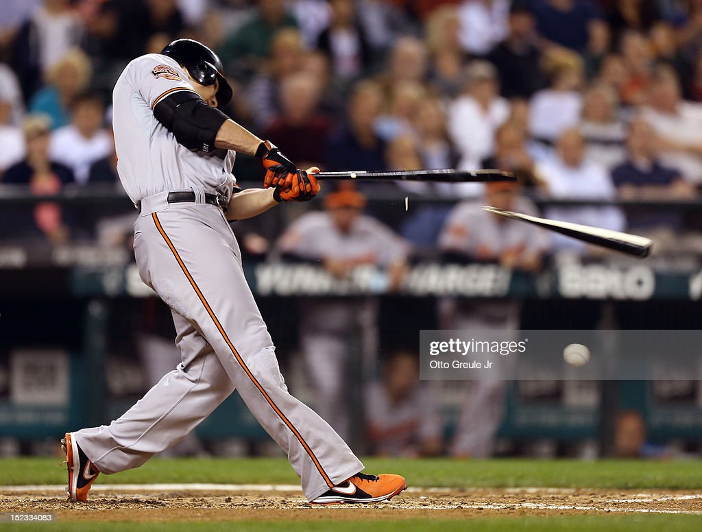 Chris Davis #19 of the Baltimore Orioles breaks his bat on a groundout in the fourth inning against the Seattle Mariners at Safeco Field on September 18, 2012 in Seattle, Washington.