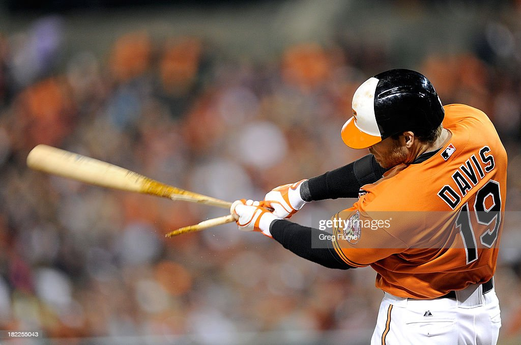 Chris Davis #19 of the Baltimore Orioles breaks his bat on a pop out in the first inning against the Boston Red Sox at Oriole Park at Camden Yards on September 28, 2013 in Baltimore, Maryland.