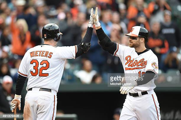 Chris Davis of the Baltimore Orioles celebrates a two run home run the fifth with Matt Wieters during a baseball game against the New York Yankees at...