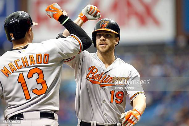 Chris Davis of the Baltimore Orioles celebrates his tworun home run with teammate Manny Machado during the third inning of a game on September 20...