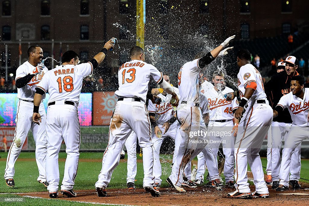 <a gi-track='captionPersonalityLinkClicked' href=/galleries/search?phrase=Chris+Davis+-+Baseball&family=editorial&specificpeople=7129264 ng-click='$event.stopPropagation()'>Chris Davis</a> #19 of the Baltimore Orioles celebrates with his teammates as he crosses home plate after hitting the game winning home run in the eleventh inning during a baseball game against the Tampa Bay Rays at Oriole Park at Camden Yards on September 2, 2015 in Baltimore, Maryland. The Baltimore Orioles defeated the Tampa Bay Rays 7-6.