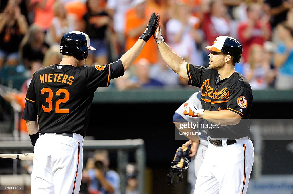 Chris Davis #19 of the Baltimore Orioles celebrates with <a gi-track='captionPersonalityLinkClicked' href=/galleries/search?phrase=Matt+Wieters&family=editorial&specificpeople=4498276 ng-click='$event.stopPropagation()'>Matt Wieters</a> #32 after hitting a home run in the third inning against the Seattle Mariners at Oriole Park at Camden Yards on August 2, 2013 in Baltimore, Maryland.