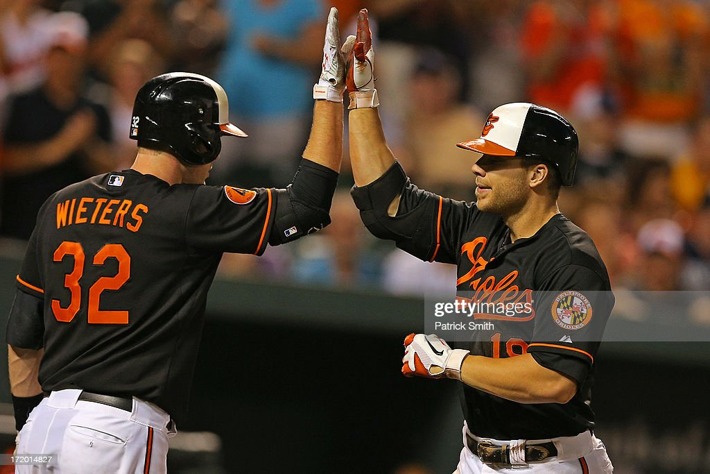 Chris Davis #19 of the Baltimore Orioles (right) celebrates with teammate <a gi-track='captionPersonalityLinkClicked' href=/galleries/search?phrase=Matt+Wieters&family=editorial&specificpeople=4498276 ng-click='$event.stopPropagation()'>Matt Wieters</a> #32 after hitting a solo home run in the second inning against the New York Yankees at Oriole Park at Camden Yards on June 30, 2013 in Baltimore, Maryland.