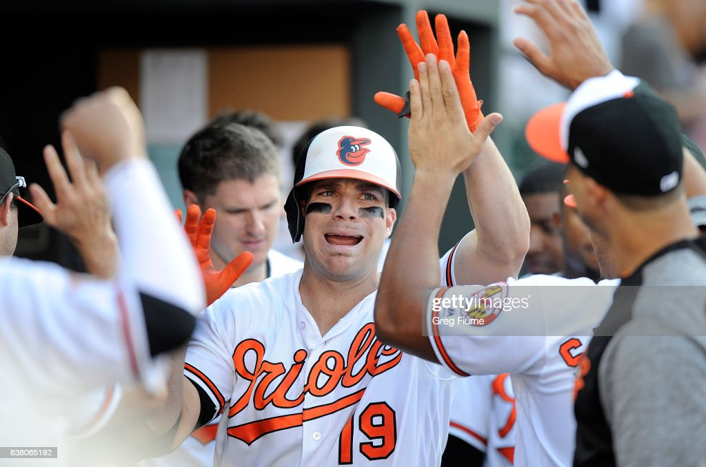 Chris Davis #19 of the Baltimore Orioles celebrates with teammates after hitting a home run in the eighth inning against the Oakland Athletics at Oriole Park at Camden Yards on August 23, 2017 in Baltimore, Maryland.