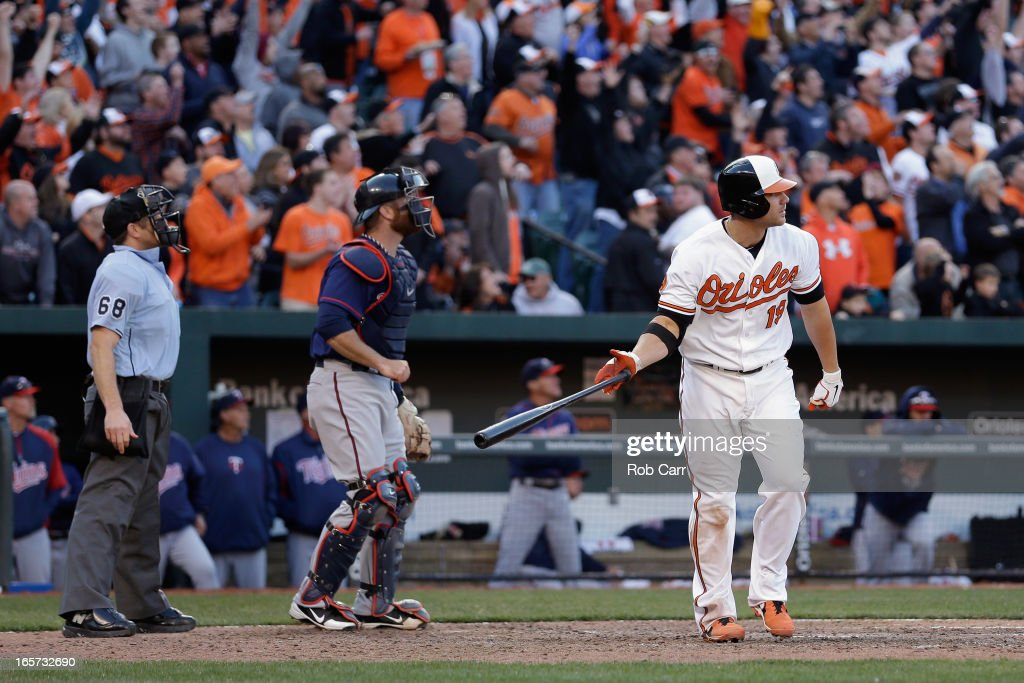 Chris Davis #19 of the Baltimore Orioles follows his eighth inning grand slam home run against the Minnesota Twins during the Orioles 9-6 opening day win at Oriole Park at Camden Yards on April 5, 2013 in Baltimore, Maryland.