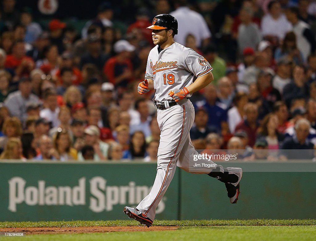 Chris Davis #19 of the Baltimore Orioles heads home after he hit a home run against the Boston Red Sox in the 6th inning at Fenway Park on August 28, 2013 in Boston, Massachusetts.
