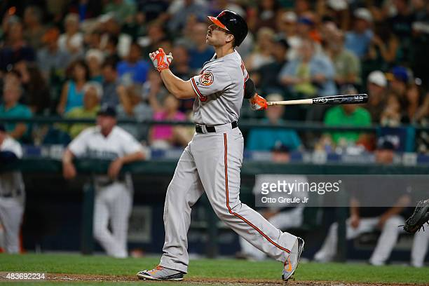 Chris Davis of the Baltimore Orioles hits a gametying solo home run in the eighth inning against the Seattle Mariners at Safeco Field on August 11...