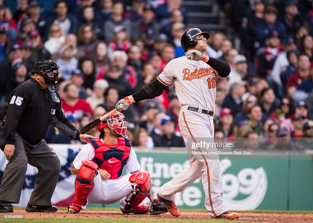 <a gi-track='captionPersonalityLinkClicked' href=/galleries/search?phrase=Chris+Davis+-+Baseball&family=editorial&specificpeople=7129264 ng-click='$event.stopPropagation()'>Chris Davis</a> #19 of the Baltimore Orioles hits a go ahead three-run home run against the Boston Red Sox in the ninth inning on April 11, 2016 at Fenway Park in Boston, Massachusetts .