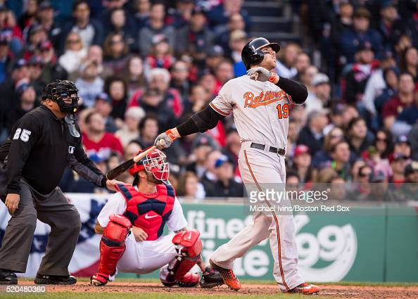 Chris Davis of the Baltimore Orioles hits a go ahead threerun home run against the Boston Red Sox in the ninth inning on April 11 2016 at Fenway Park...