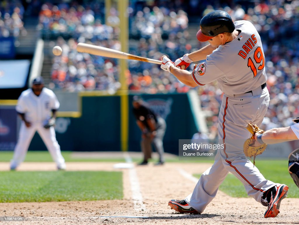 Chris Davis #19 of the Baltimore Orioles hits a ground-rule double against the Detroit Tigers that drove in Manny Machado in the seventh inning at Comerica Park on June 19, 2013 in Detroit, Michigan. Davis went 3-for-5 at the plate, including two home runs, in a 13-3 win.
