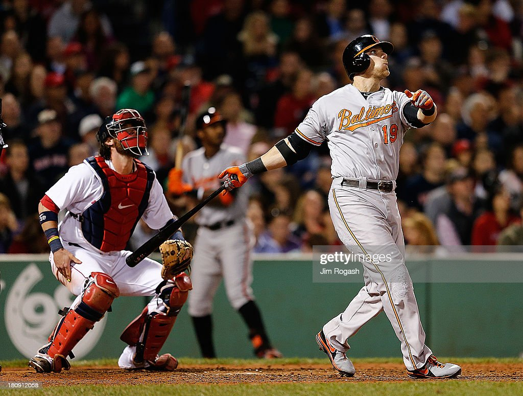 Chris Davis #19 of the Baltimore Orioles hits a home run in the 6th inning against the Boston Red Sox at Fenway Park on September 17 in Boston, Massachusetts.