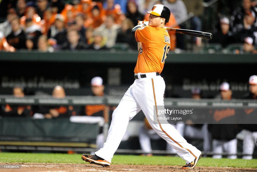 Chris Davis #19 of the Baltimore Orioles hits a single to score teams first run during the second inning of a baseball game against the Oakland Athletics at Oriole Park at Camden Yards on April 28, 2012 in Baltimore, Maryland.