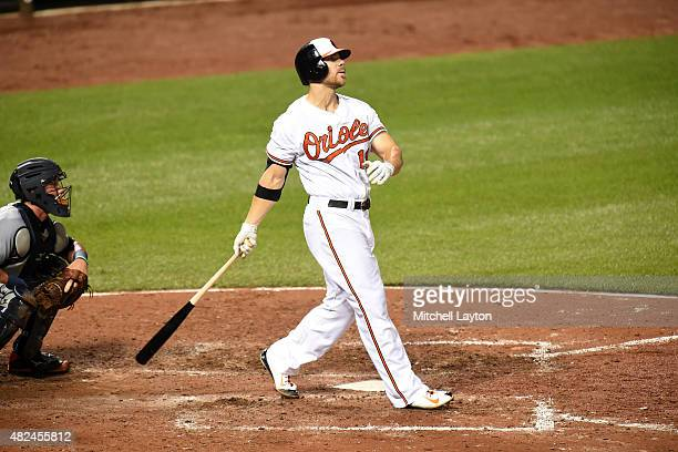 Chris Davis of the Baltimore Orioles hits a solo home run in the sixth inning during a baseball game against the Detroit Tigers at Oriole Park at...