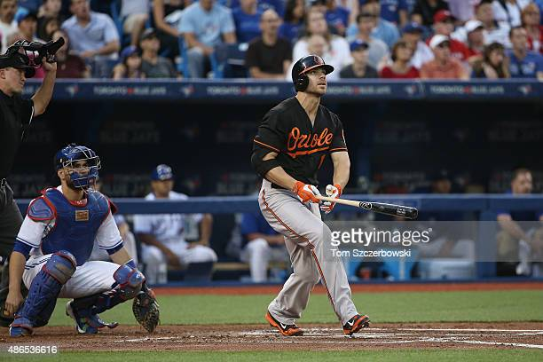 Chris Davis of the Baltimore Orioles hits a solo home run in the second inning during MLB game action against the Toronto Blue Jays on September 4...