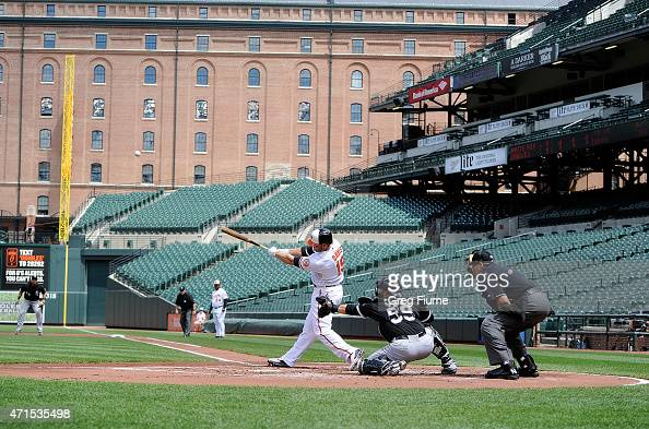 Chris Davis of the Baltimore Orioles hits a threerun home run in the first inning against the Chicago White Sox at Oriole Park at Camden Yards on...
