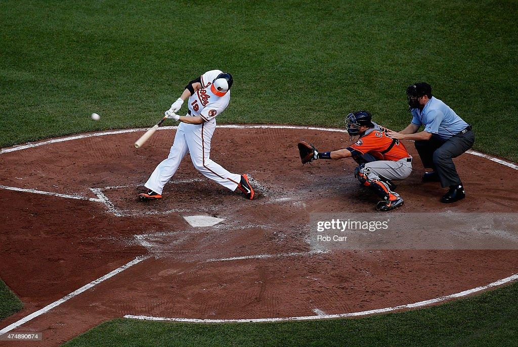 <a gi-track='captionPersonalityLinkClicked' href=/galleries/search?phrase=Chris+Davis+-+Baseball+Player&family=editorial&specificpeople=7129264 ng-click='$event.stopPropagation()'>Chris Davis</a> #19 of the Baltimore Orioles hits a two RBI home run as catcher <a gi-track='captionPersonalityLinkClicked' href=/galleries/search?phrase=Jason+Castro+-+Baseball+Player&family=editorial&specificpeople=7443916 ng-click='$event.stopPropagation()'>Jason Castro</a> #15 of the Houston Astros and home plate umpire Dan Bellino look on during the fourth inning at Oriole Park at Camden Yards on May 27, 2015 in Baltimore, Maryland.
