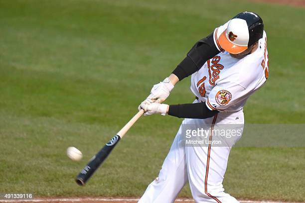 Chris Davis of the Baltimore Orioles hits a two run home run in the eight inning during a baseball game against the New York Yankees at Oriole Park...