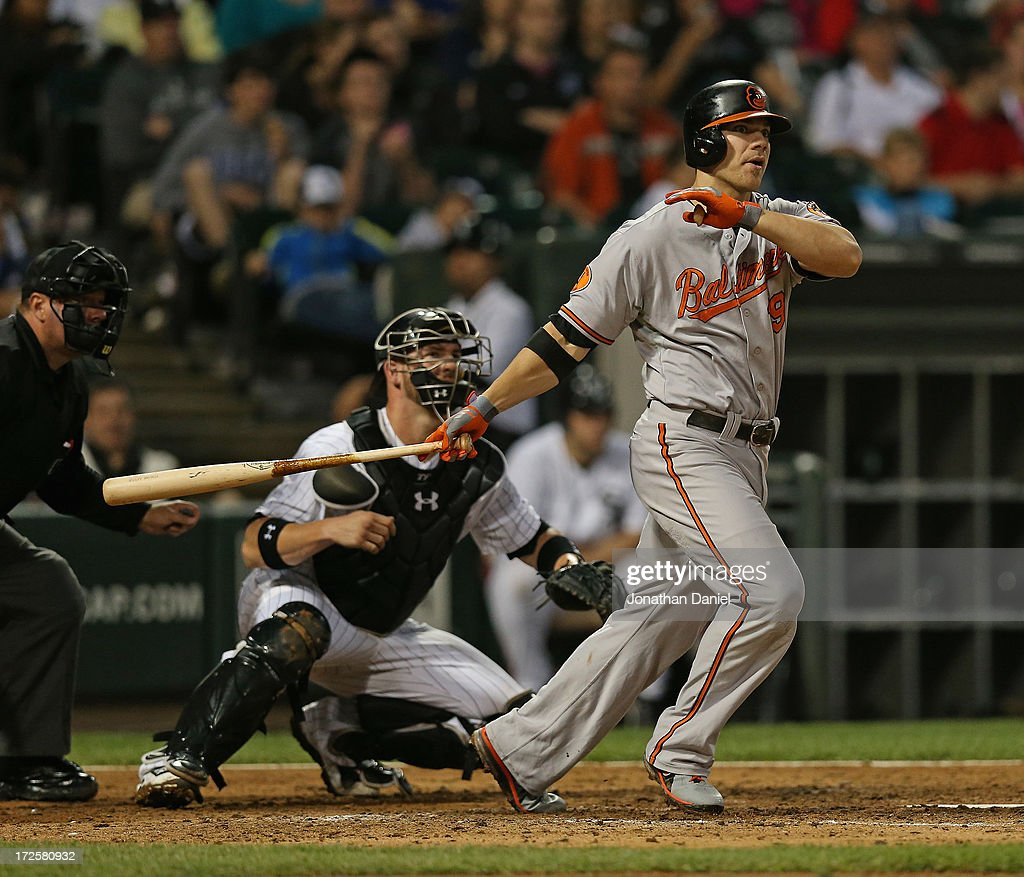 Chris Davis #19 of the Baltimore Orioles hits a two-run double in the 8th inning against the Chicago White Sox at U.S. Cellular Field on July 3, 2013 in Chicago, Illinois.