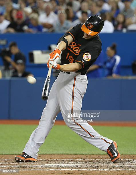 Chris Davis of the Baltimore Orioles hits a tworun home run in the sixth inning during MLB game action against the Toronto Blue Jays on September 4...