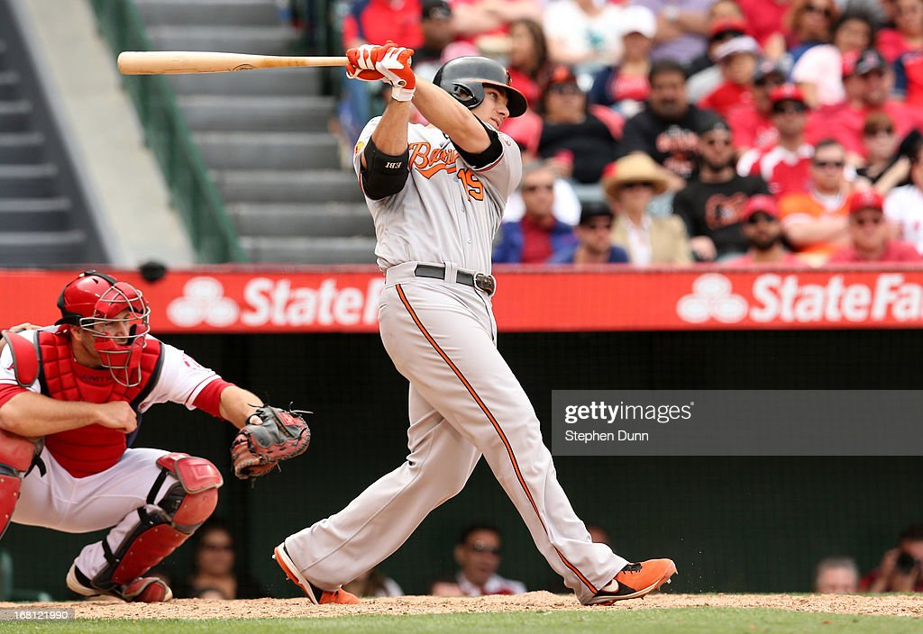 Chris Davis #19 of the Baltimore Orioles hits an RBI single in the eighth inning against the Los Angeles Angels of Anaheim at Angel Stadium of Anaheim on May 5, 2013 in Anaheim, California.