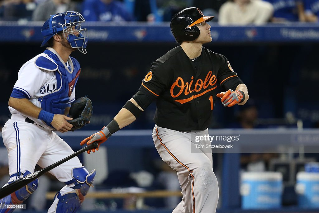 Chris Davis #19 of the Baltimore Orioles hits his fiftieth home run of the season in the eighth inning connecting on a solo home run during MLB game action against the Toronto Blue Jays on September 13, 2013 at Rogers Centre in Toronto, Ontario, Canada.