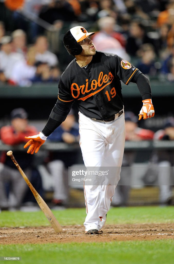 Chris Davis #19 of the Baltimore Orioles hits his league-leading 53rd home run in the sixth inning against the Boston Red Sox at Oriole Park at Camden Yards on September 27, 2013 in Baltimore, Maryland.