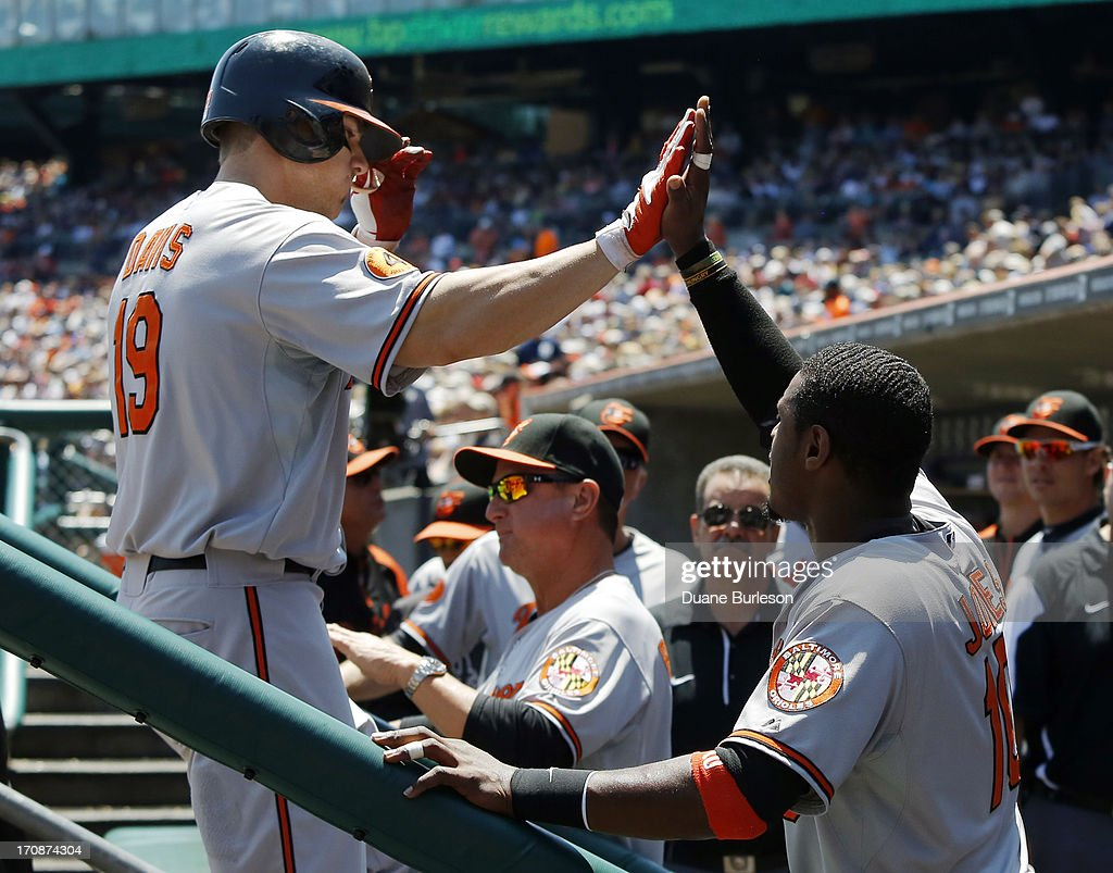 Chris Davis #19 of the Baltimore Orioles is congratulated by Adam Jones #10 after hitting a two-run home run against the Detroit Tigers in the fourth inning at Comerica Park on June 19, 2013 in Detroit, Michigan. The Orioles defeated the Tigers 13-3.