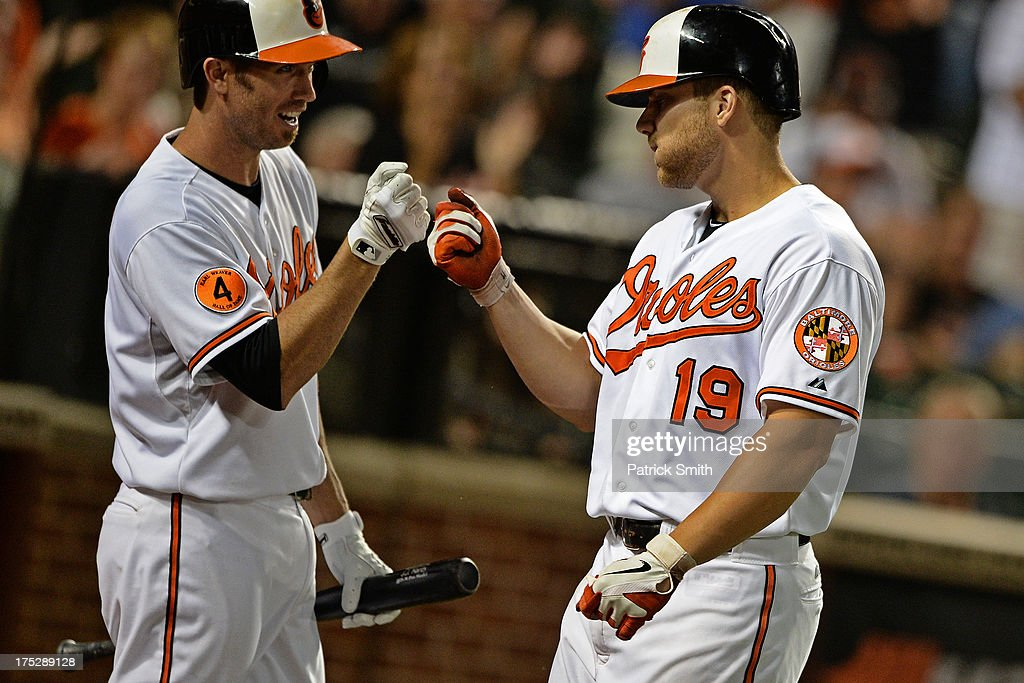 Chris Davis #19 of the Baltimore Orioles is greeted by teammate <a gi-track='captionPersonalityLinkClicked' href=/galleries/search?phrase=J.J.+Hardy&family=editorial&specificpeople=216446 ng-click='$event.stopPropagation()'>J.J. Hardy</a> #2 after hitting a home run in the seventh inning against the Houston Astros at Oriole Park at Camden Yards on August 1, 2013 in Baltimore, Maryland. The Baltimore Orioles won, 6-3.