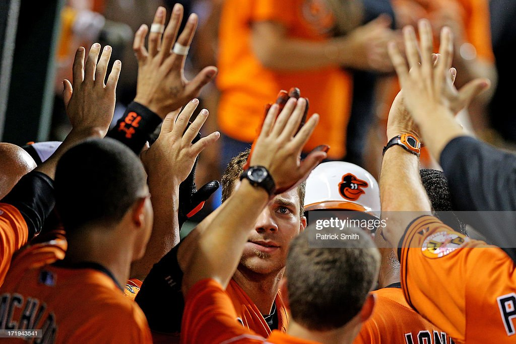 Chris Davis #19 of the Baltimore Orioles is greeted in the dugout after hitting a two-run home run against the New York Yankees in the sixth inning at Oriole Park at Camden Yards on June 29, 2013 in Baltimore, Maryland. The Baltimore Orioles won, 11-3.