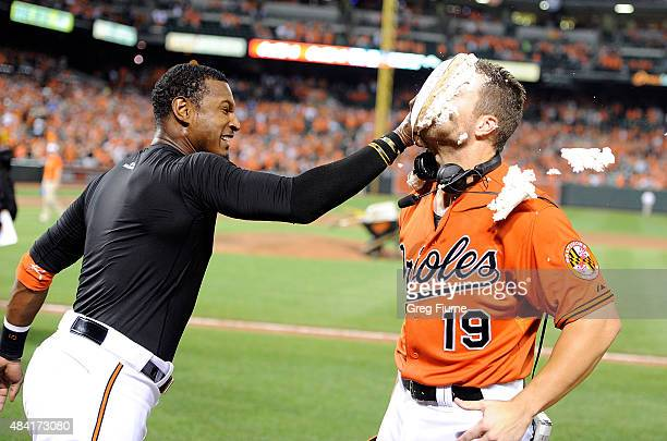 Chris Davis of the Baltimore Orioles is pied by Adam Jones after hitting a walkoff home run in the ninth inning against the Oakland Athletics at...