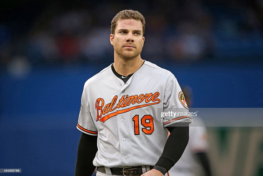 <a gi-track='captionPersonalityLinkClicked' href=/galleries/search?phrase=Chris+Davis+-+Baseball&family=editorial&specificpeople=7129264 ng-click='$event.stopPropagation()'>Chris Davis</a> #19 of the Baltimore Orioles reacts after being stranded at the end of the second inning during MLB game action against the Toronto Blue Jays on August 7, 2014 at Rogers Centre in Toronto, Ontario, Canada.
