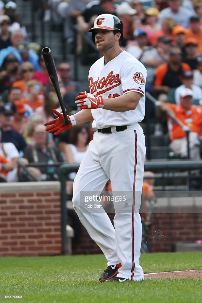 Chris Davis #19 of the Baltimore Orioles reacts after striking out for the first out of the eighth inning against the Chicago White Sox at Oriole Park at Camden Yards on September 8, 2013 in Baltimore, Maryland.