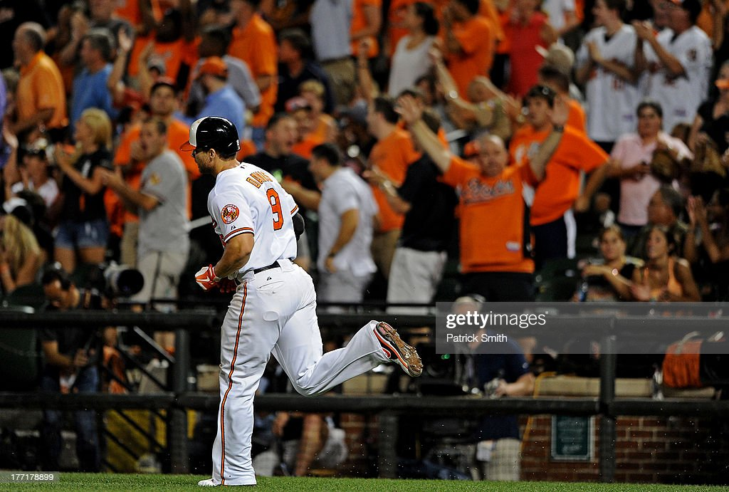 Chris Davis #19 of the Baltimore Orioles rounds the bases after hitting a home run against the Tampa Bay Rays in the fifth inning at Oriole Park at Camden Yards on August 21, 2013 in Baltimore, Maryland. The Baltimore Orioles won, 4-2.