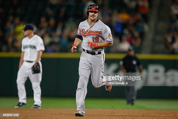 Chris Davis of the Baltimore Orioles rounds the bases after hitting a gametying solo home run in the eighth inning against the Seattle Mariners at...