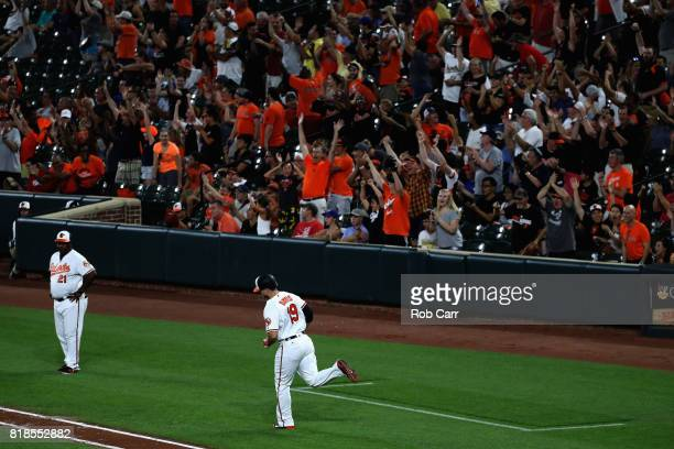 Chris Davis of the Baltimore Orioles rounds the bases after hitting a fourth inning grand slam against the Texas Rangers at Oriole Park at Camden...