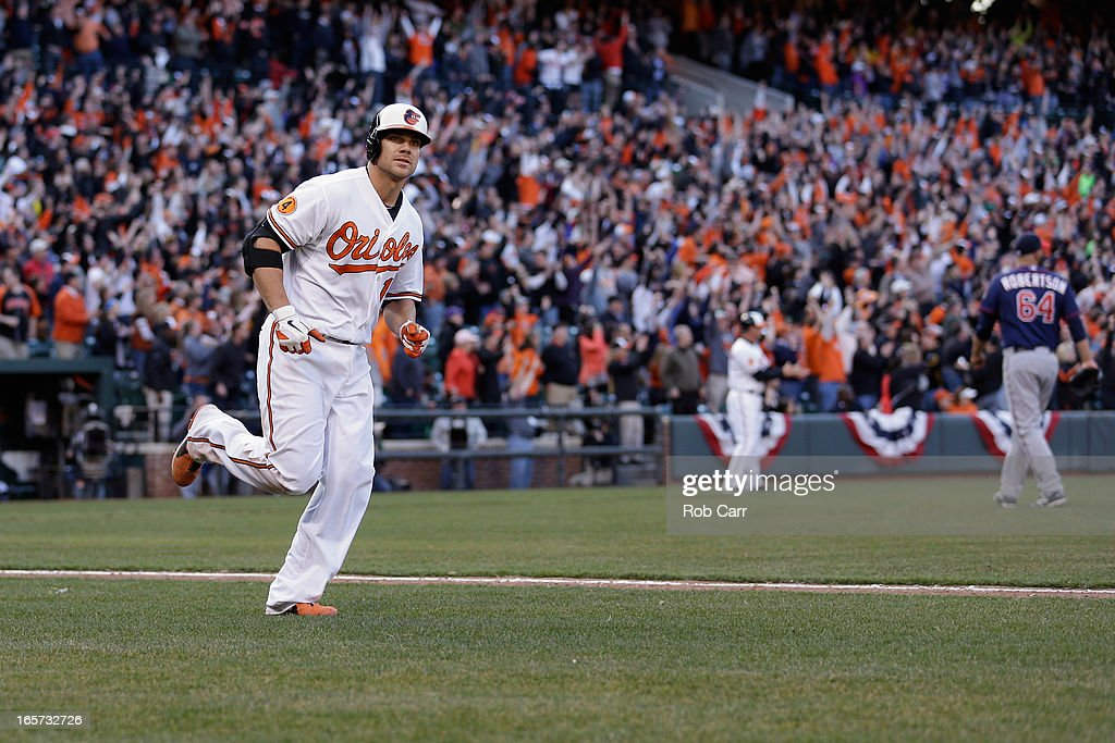 Chris Davis #19 of the Baltimore Orioles rounds the bases after hitting an eighth inning grand slam home run against the Minnesota Twins during the Orioles 9-6 opening day win at Oriole Park at Camden Yards on April 5, 2013 in Baltimore, Maryland.