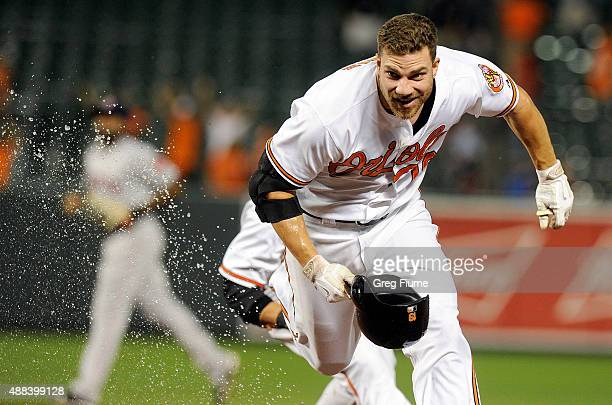 Chris Davis of the Baltimore Orioles runs away from his teammates after driving in the gamewinning run with a single in the 13th inning against the...