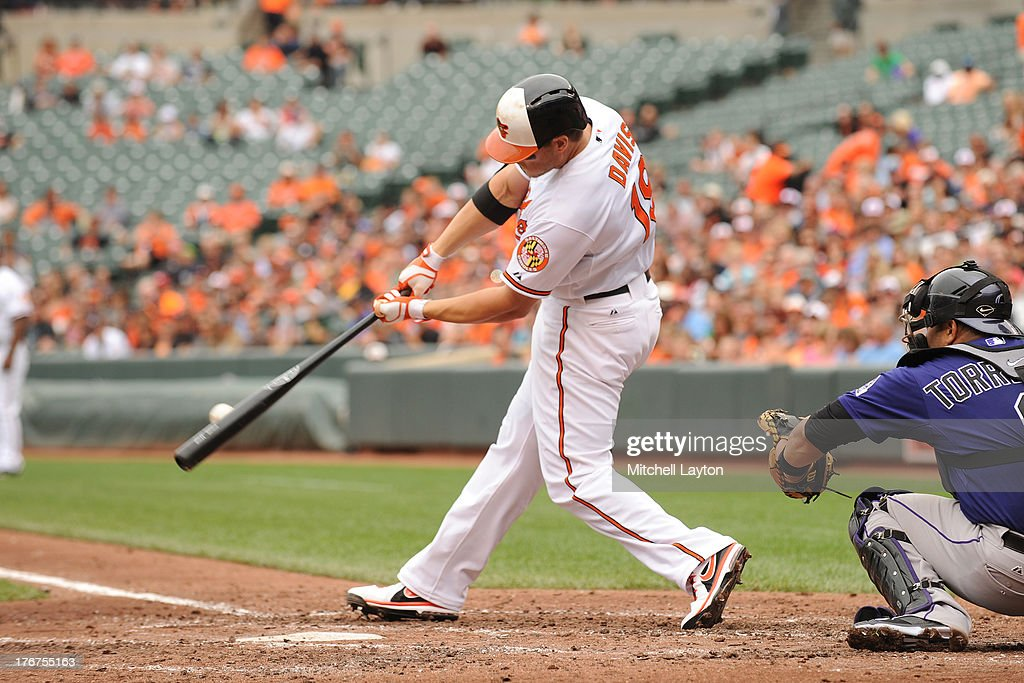 Chris Davis #19 of the Baltimore Orioles singles in the third inning during a baseball game against the Colorado Rockies on August 18, 2013 at Oriole Park at Camden Yards in Baltimore, Maryland. The Orioles won 7-2.