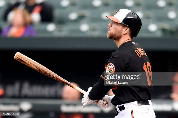 Chris Davis of the Baltimore Orioles takes a swing during game one of a baseball game against the New York Yankees at Oriole Park at Camden Yards on...