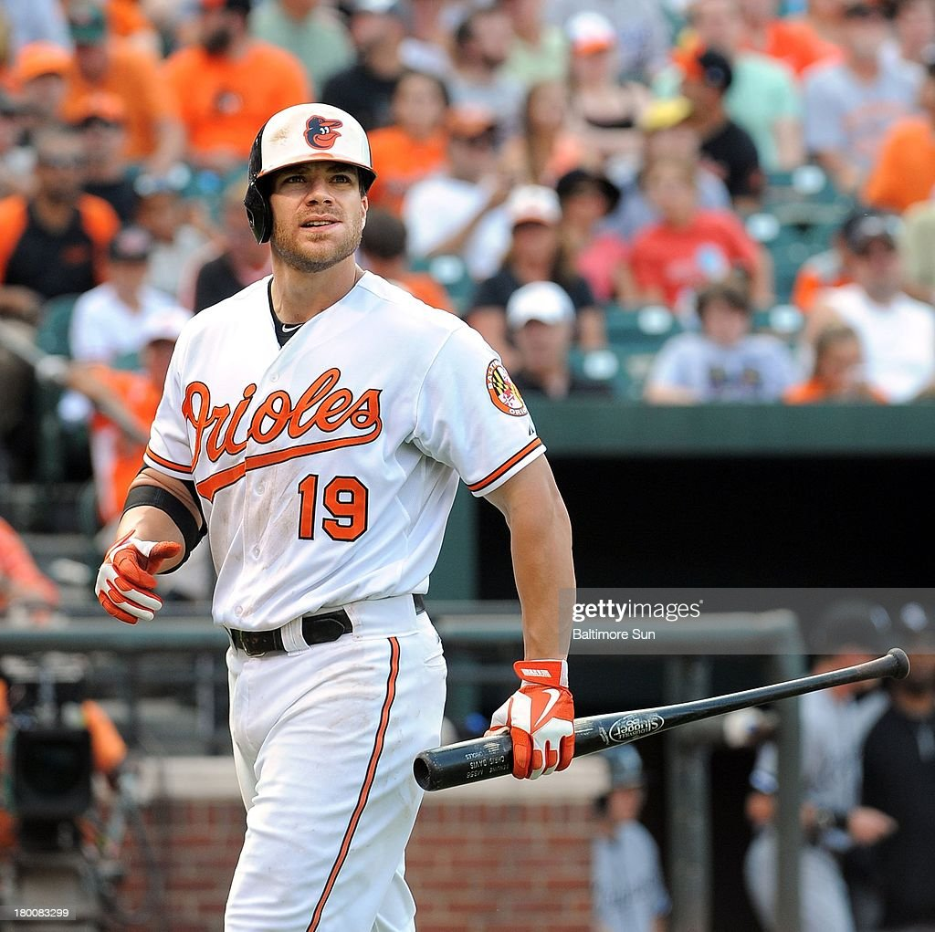Chris Davis of the Baltimore Orioles walks back to the dug out after striking out in the 8th inning against the Chicago White Sox at Oriole Park at Camden Yards in Baltimore, Maryland, Sunday, September 8, 2013.