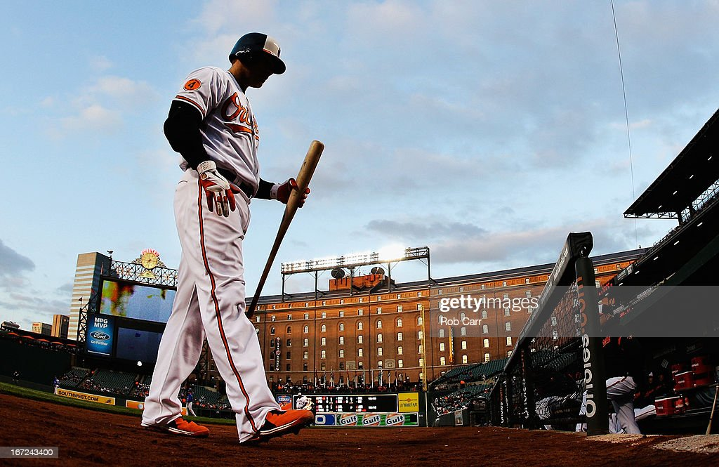 Chris Davis #19 of the Baltimore Orioles walks back to the dugout after striking out against the Toronto Blue Jays during the second inning at Oriole Park at Camden Yards on April 22, 2013 in Baltimore, Maryland.